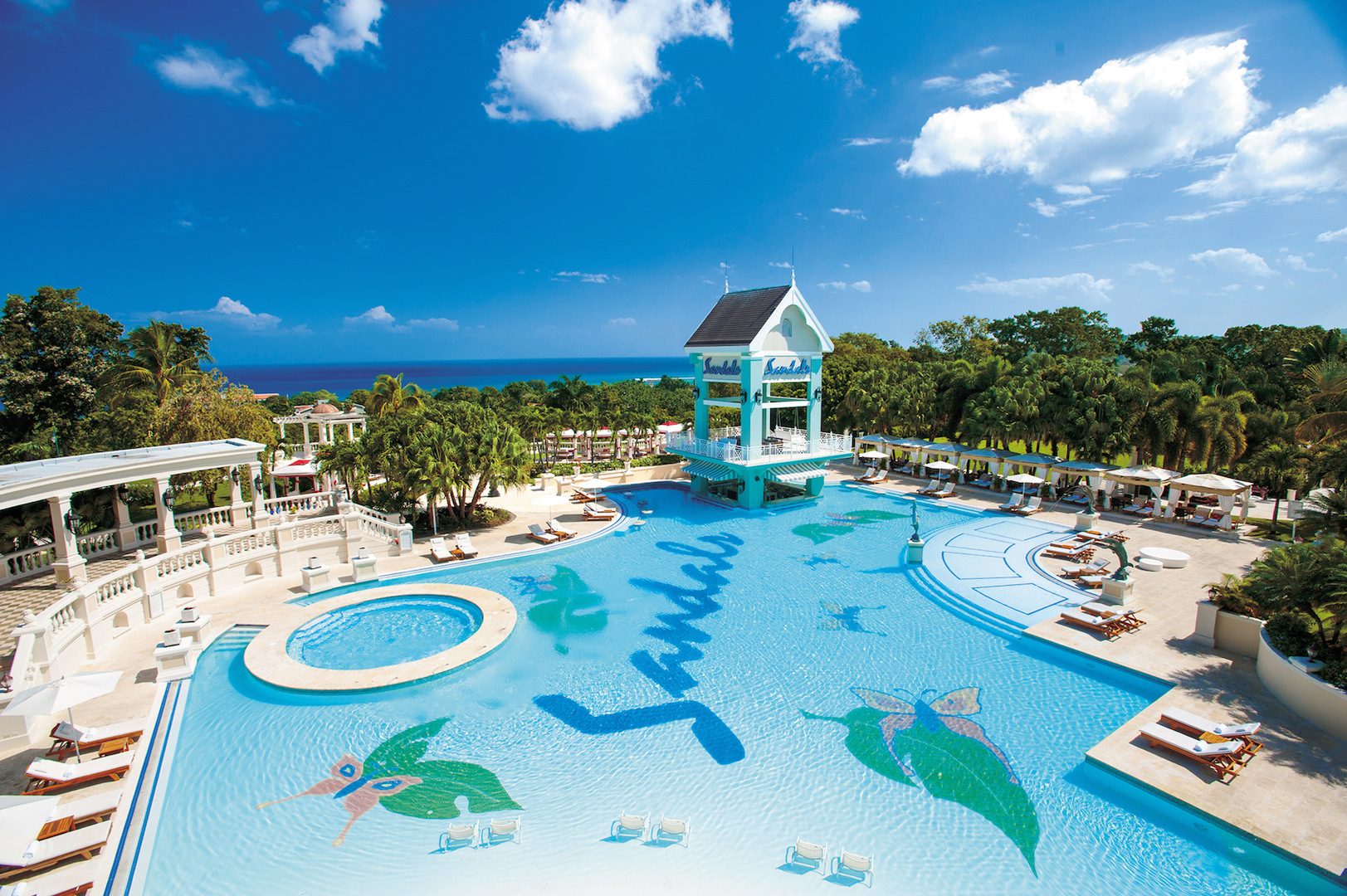 Sandals Royal Caribbean. Sandals Royal Caribbean resort is located just short drive from the downtown, between several other resorts. What makes this resort stand out is its private island with a Thai restaurant, additional beach and pool amenities.